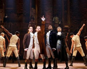 "Miguel Cervantes (Hamilton) points up amid the cast of ""Hamilton"". Photo by Joan Marcus"