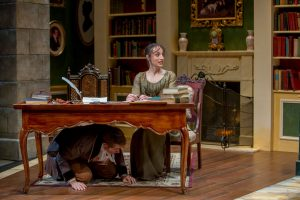 Erik Hellman (Arthur) hides under the desk from Lydia protected by Emily Berman (Mary) Charles Osgood Photography