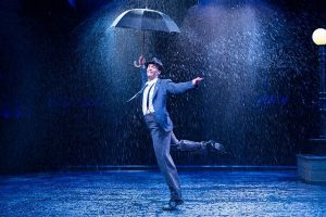 Danny Gardner as Don Lockwood in 'Singing in the Rain' at Marriott Theatre. Justin Barbin photo
