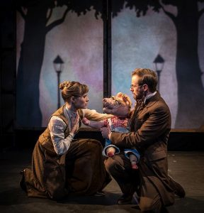 One of the three little pigs tells Lindsey Noel Whiting (Mrs. Pennyworth) and Samuel Taylor (Mr. Pennyworth) that the wolf has been murdered but not by a hunter. Photo by Liz Lauren