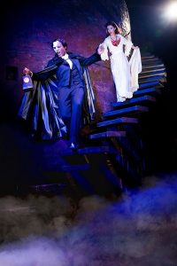 Derick Davis as The Phantom leads Katie Travis (Christine) to his underground hideaway. Photo by Matthew Murphy