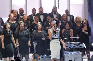 Michelle Williams backed by the Trinity Mass Choir at the Chicago Voices Concert. Photo by Cory Weaver