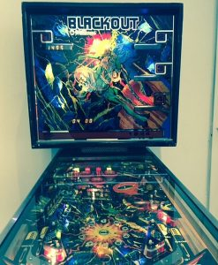 A pinball machine on exhibit at the Elmhurst Art Museum with backglass art designed by Ed Paschke. Photo by Jodie Jacobs