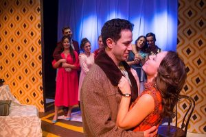 "Dan Gold (Vernon) and Carmen Risi (Sonia) and company in ""They're Playing Our Song."" A Brown Paper Box Co. photo"