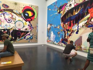 "Visitors were taking photos of Takashi Murakami's works throughout the exhibit at the MCA. This room held ""Tan Tan Bo Puking - aka Gero Tanm 2002, courtesy of Galerie Perrotin and its companion piece. Photo by Jodie Jacobs"