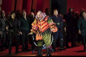 Rigoletto (Quinn Kelsey) center and couriers in )Lyric Opera production of Verdi's Rigoletto. (Todd Rosenberg photo)