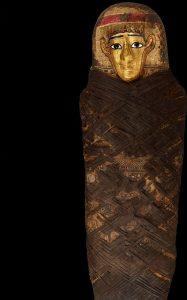 Segment of photo by John Weinstein of a the Gilded Lady coffin from between 30 BC and 646 A, Egypt.