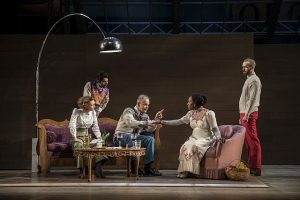 Rebecca Hurd (Petra), Jesse Bhamrah (Billing), Philip Earl Johnson (Thomas Stockman), Lanise Antoine Shelley (Katherine) and Aubrey Deeker Hernandez (Hovstad) in An Enemy of the People at Goodman Theatre. Photo by Liz L:auren