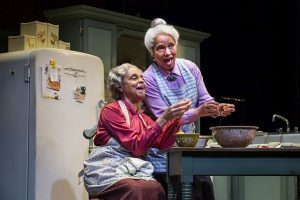 Marie Thomas (Sadie) and Ella Joyce (Bessie) reminisce as they prepare a meal in their Mt. Vernon, NY home in Having Our Say at the Goodman Theatre.