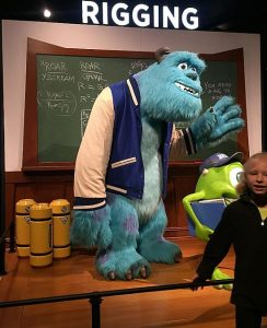 Posing with a Pixar character is part of the exhibit experience.