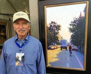 Rogers Naylor at his painting used as this year's fair poster (Photosby Reno Lovison)