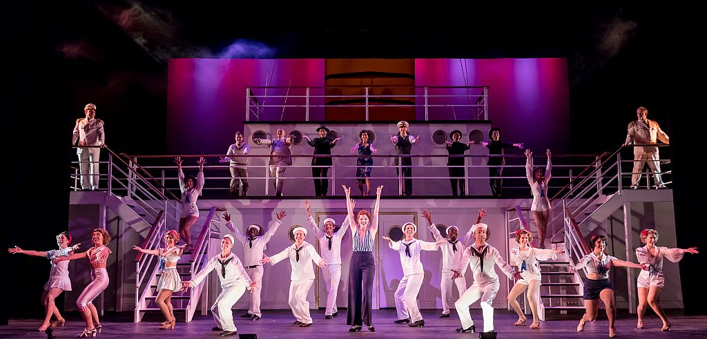 Erica Evans, c, steps to it with the cast of 'Anything Goes.' ( Photo by Brett Beiner )