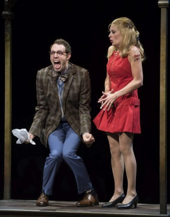Alex Goodrich (Oscar) and Anne Horak (Charity) get stuck in an elevator in 'Sweet Charity.' (Photo by Michael Brosilow)