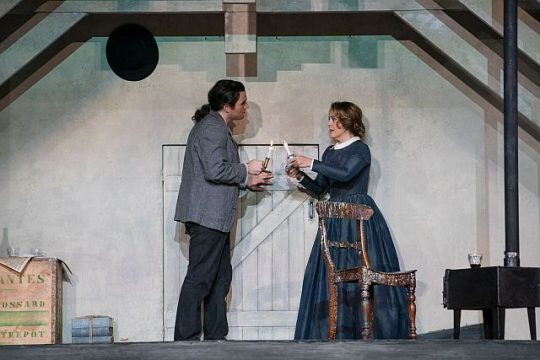 Michael Fabiano (Rodolfo) and Maria Agresta (Mimi) meet when she comes to his garret. (Todd Rosenberg photo)