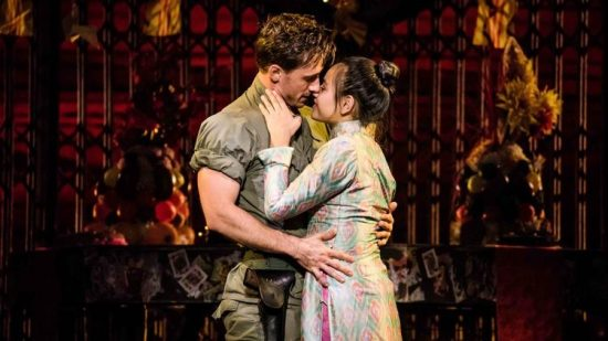 Anthony Festa (Chris) and Emily Bautista (Kim) in Miss Saigon at the Cadillac Palace Theatre. (Matthew Murphy photo)