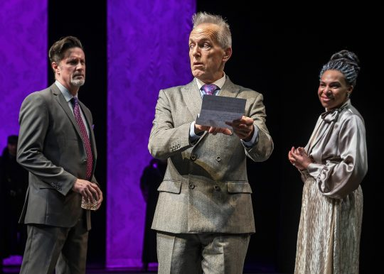 Polonius (Larry Yando, at center) reveals to King Claudius (Tim Decker) and Queen Gertrude (Karen Aldridge) the contents of Hamlet's letter to Ophelia in Chicago Shakespeare Theater's production of Hamlet, (Photo by Liz Lauren)