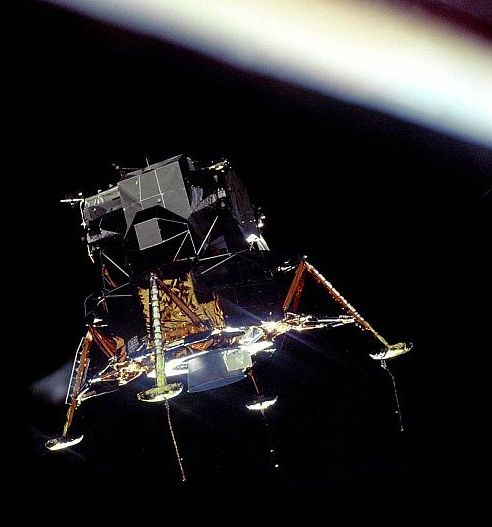 The Eagle Prepares to Land The Apollo 11 Lunar Module Eagle, in a landing configuration was photographed in lunar orbit from the Command and Service Module Columbia. Inside the module were Commander Neil A. Armstrong and Lunar Module Pilot Buzz Aldrin. The long rod-like protrusions under the landing pods are lunar surface sensing probes. (Photo and text courtesy of NASA)