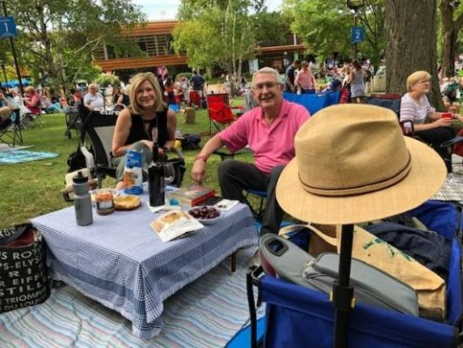 Frequent Revinia goers, Donna and Dan Berman, Deerfield, know to get to popular concerts early. and Dan knows to bring a hat because the sun changes. (J Jacobs photo)